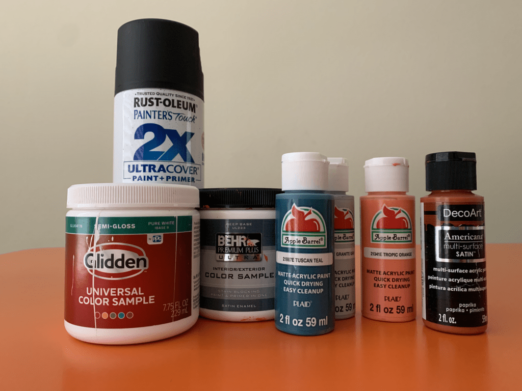 Various paints: acrylic, spray paint, and wall paint