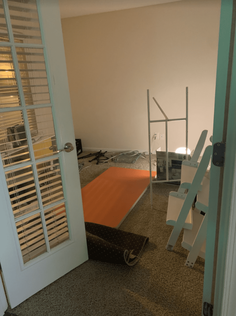Office with unassembled furniture