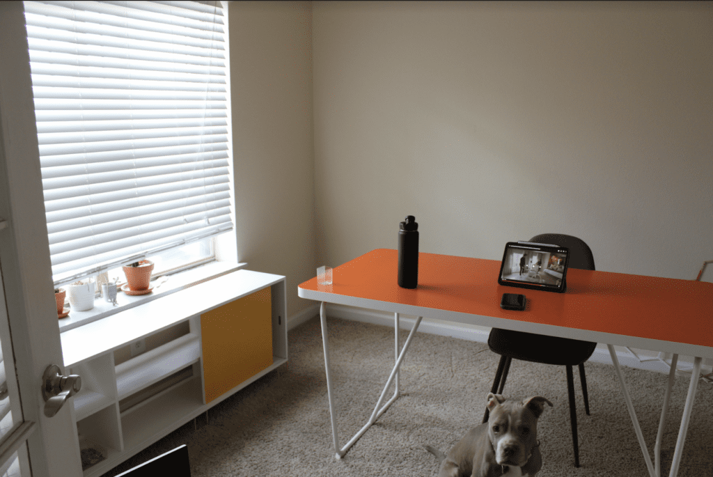 undecorated office with shelf and desk