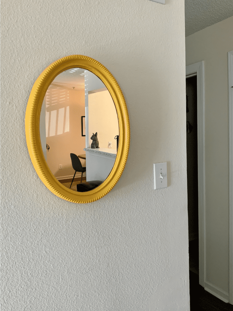 Yellow oval mirror