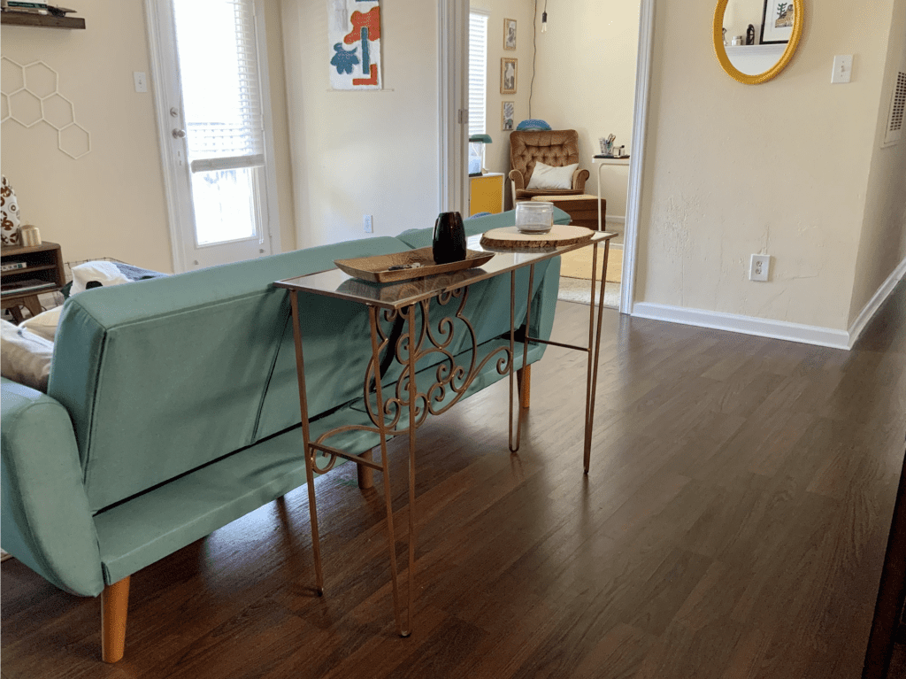 thrifted copper-colored iron sofa table