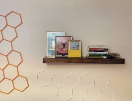 good clutter - floating shelves with books and picture frames