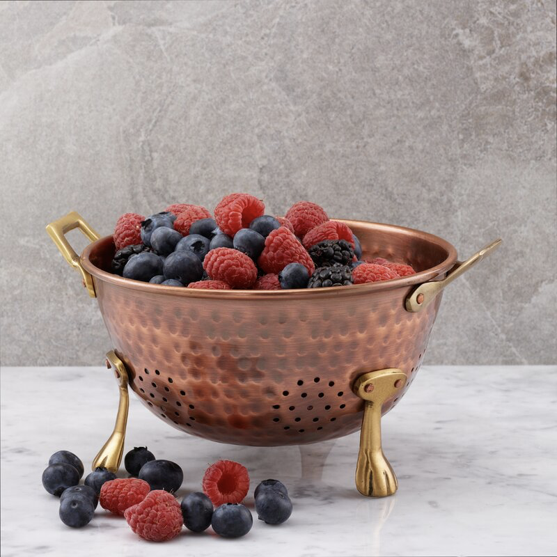 brass collander with berries inside - non-cheesy halloween decorations